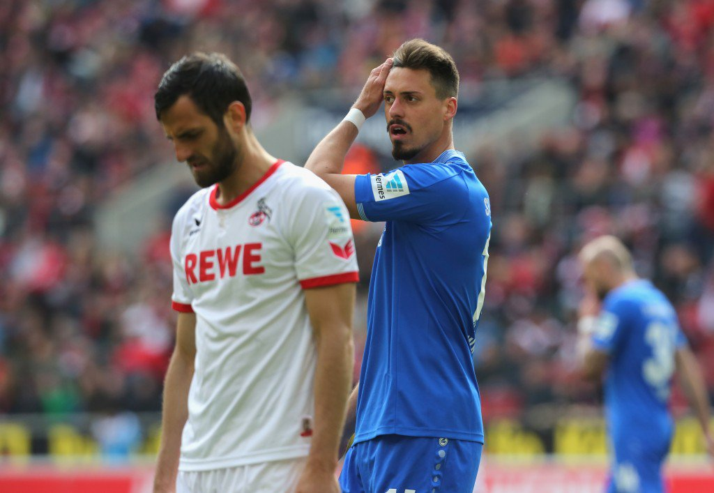 COLOGNE, GERMANY - APRIL 23: Sandro Wagner of Darmstadt (R) touches his head beside Mergim Mavraj of Cologne during the Bundesliga match between 1. FC Koeln and SV Darmstadt 98 at RheinEnergieStadion on April 23, 2016 in Cologne, Germany. (Photo by Juergen Schwarz/Bongarts/Getty Images)