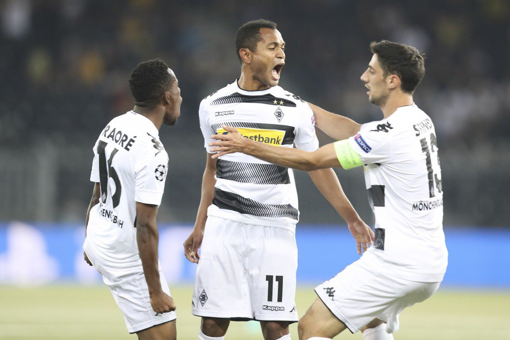 BERN, SWITZERLAND - AUGUST 16: Raffael Caetano de Araujo of Borussia Moenchengladbach (C) celebrates his goal (0:1) with Ibrahima Traore (L) and Lars Stindl of Borussia Moenchengladbach (R) during the Champions League Playoff match between Young Boys Bern and Borussia Moenchengladbach at Stade de Suisse on August 16, 2016 in Bern, Switzerland. (Photo by Marc Eich/Bongarts/Getty Images)