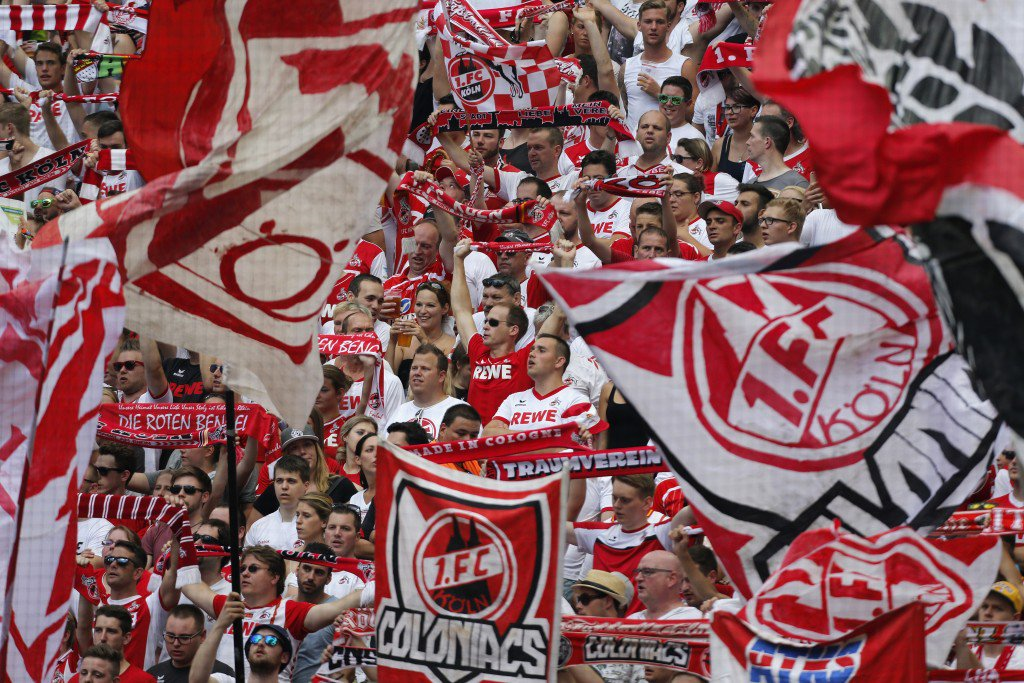 COLOGNE, NORTH RHINE-WESTPHALIA - AUGUST 27: Cologne fans support their team during the Bundesliga match between 1. FC Koeln and SV Darmstadt 98 at RheinEnergieStadion on August 27, 2016 in Cologne, Germany. (Photo by Juergen Schwarz/Bongarts/Getty Images)