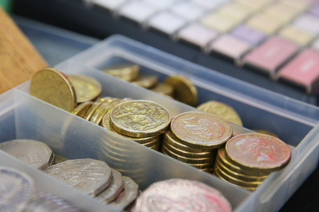 MELBOURNE, AUSTRALIA - OCTOBER 24: Dollar coins are seen on a bookies desk during Cox Plate Day at Moonee Valley Racecourse on October 24, 2015 in Melbourne, Australia. (Photo by Michael Dodge/Getty Images)