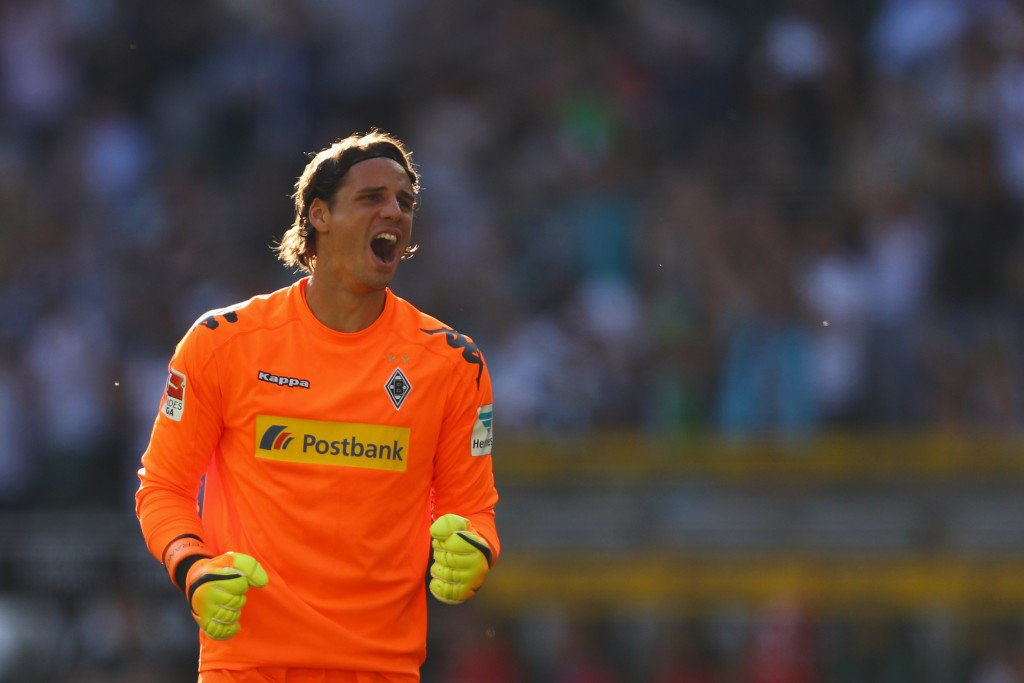 MOENCHENGLADBACH, GERMANY - SEPTEMBER 24: Goalkeeper, Yann Sommer of Borussia Moenchengladbach celebrates the goal from Oscar Wendt #17 of Borussia Moenchengladbach after he scores his teams second goal of the game during the Bundesliga match between Borussia Moenchengladbach and FC Ingolstadt 04 at Borussia-Park on September 24, 2016 in Moenchengladbach, Germany. (Photo by Dean Mouhtaropoulos/Bongarts/Getty Images)