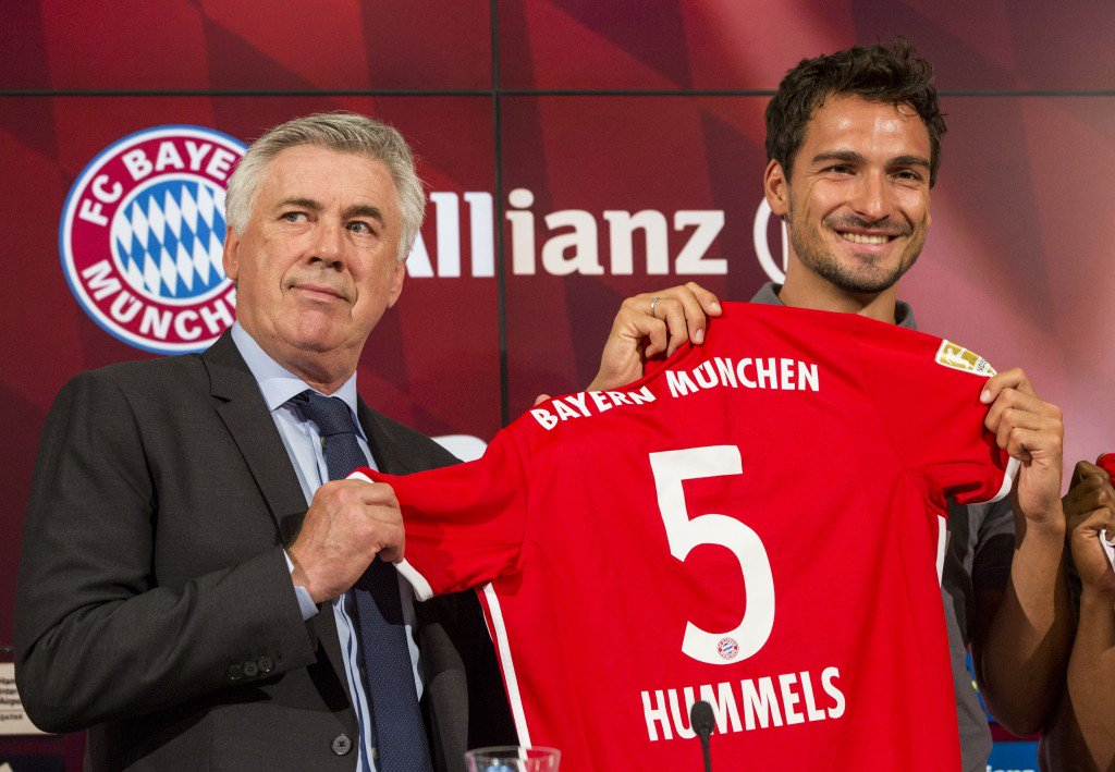 MUNICH, GERMANY - AUGUST 06: Carlo Ancelotti (L) and Mats Hummels are seen during a press conference of FC Bayern Munich at Allianz Arena on August 6, 2016 in Munich, Germany. (Photo by Marc Mueller/Bongarts/Getty Images)