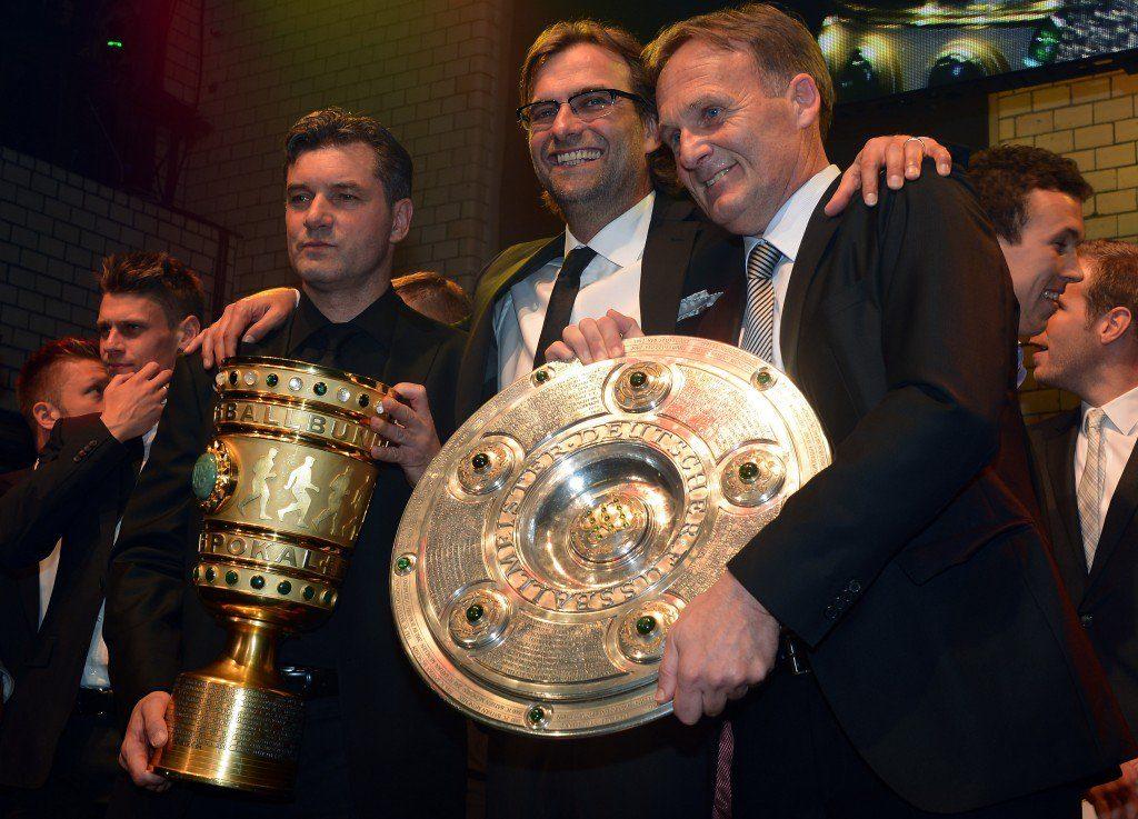 Mit Jürgen Klopp (m.) und Manager Michael Zorc (l.) führte Hans-Joachim Watzke den BVB ab 2008 in eine goldene Ära