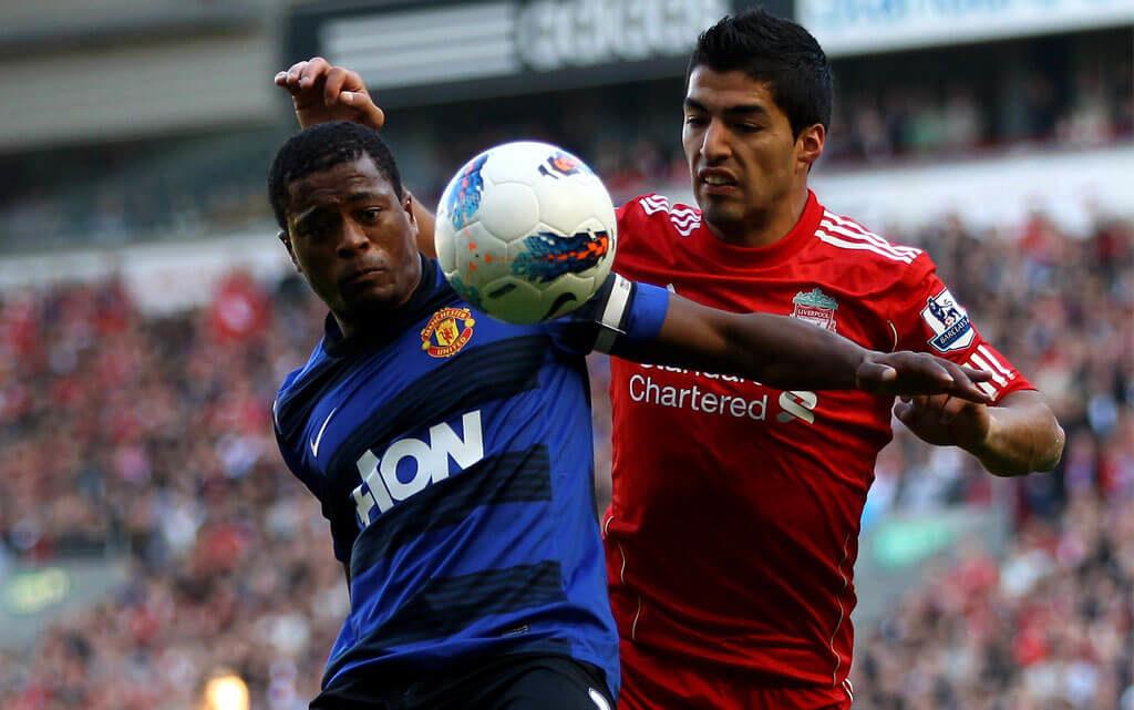 Patrice Evra vs Luis Suarez. Foto: Getty Images