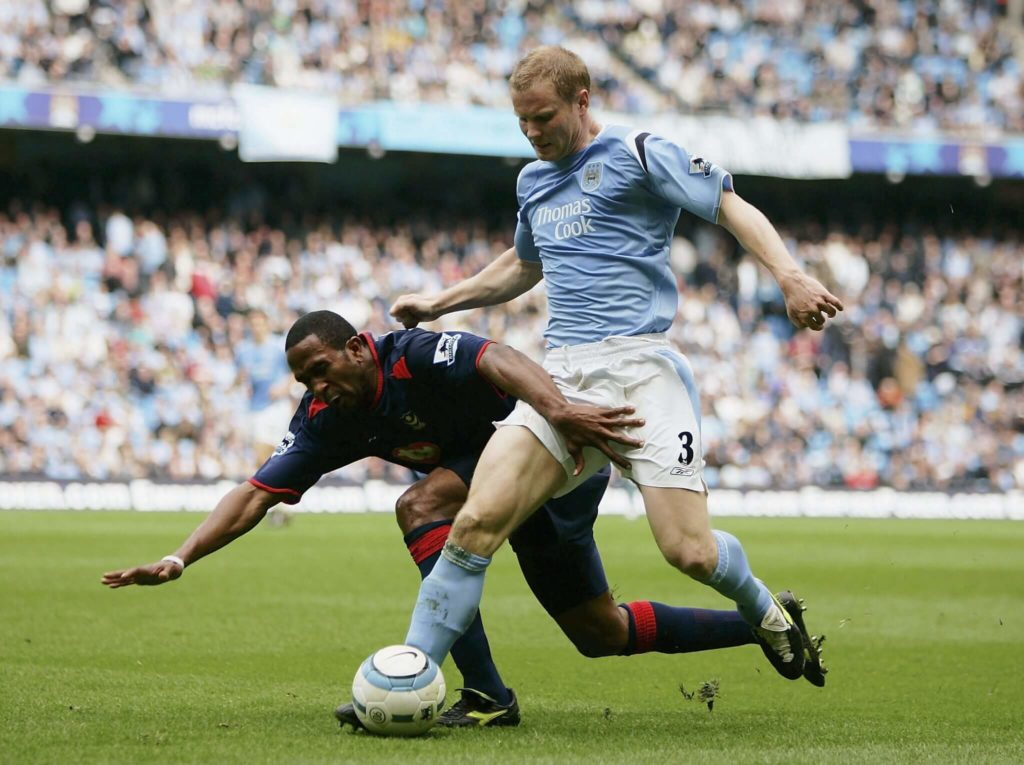 MANCHESTER, ENGLAND - APRIL 30: Ben Thatcher of Manchester City is tackled by Ricardo Fuller of Portsmouth during the Barclays Premiership match between Manchester City and Portsmouth at the City of Manchester Stadium on April 30, 2005 in Manchester, England. (Photo by Bryn Lennon/Getty Images)