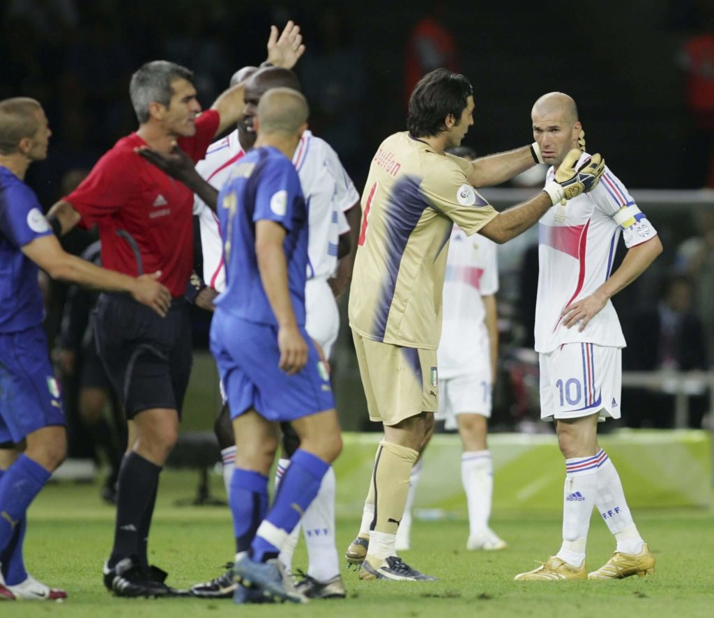 BERLIN - JULY 09: Goalkeeper Gianluigi Buffon (2nd L) of Italy consoles Zinedine Zidane (R) of France, as he is shown the red card by Referee Horacio Elizondo of Argentina during the FIFA World Cup Germany 2006 Final match between Italy and France at the Olympic Stadium on July 9, 2006 in Berlin, Germany. (Photo by Andreas Rentz/Bongarts/Getty Images)