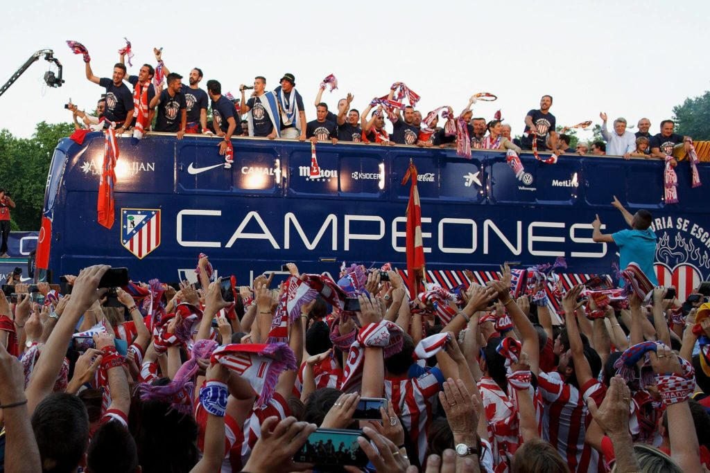 MADRID, SPAIN - MAY 18: Club Atletico de Madrid players arrive on bus celebrating with the fans after their tenth La Liga title at Neptuno Square on May 18, 2014 in Madrid, Spain. (Photo by Pablo Blazquez Dominguez/Getty Images)