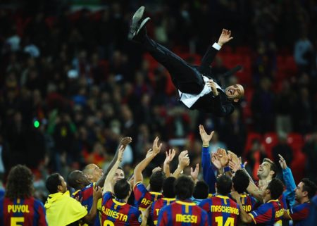 LONDON, ENGLAND - MAY 28: Josep Guardiola manager of FC Barcelona is thrown in the air as Barcelona celebrate victory in UEFA Champions League final between FC Barcelona and Manchester United FC at Wembley Stadium on May 28, 2011 in London, England. (Photo by Laurence Griffiths/Getty Images)