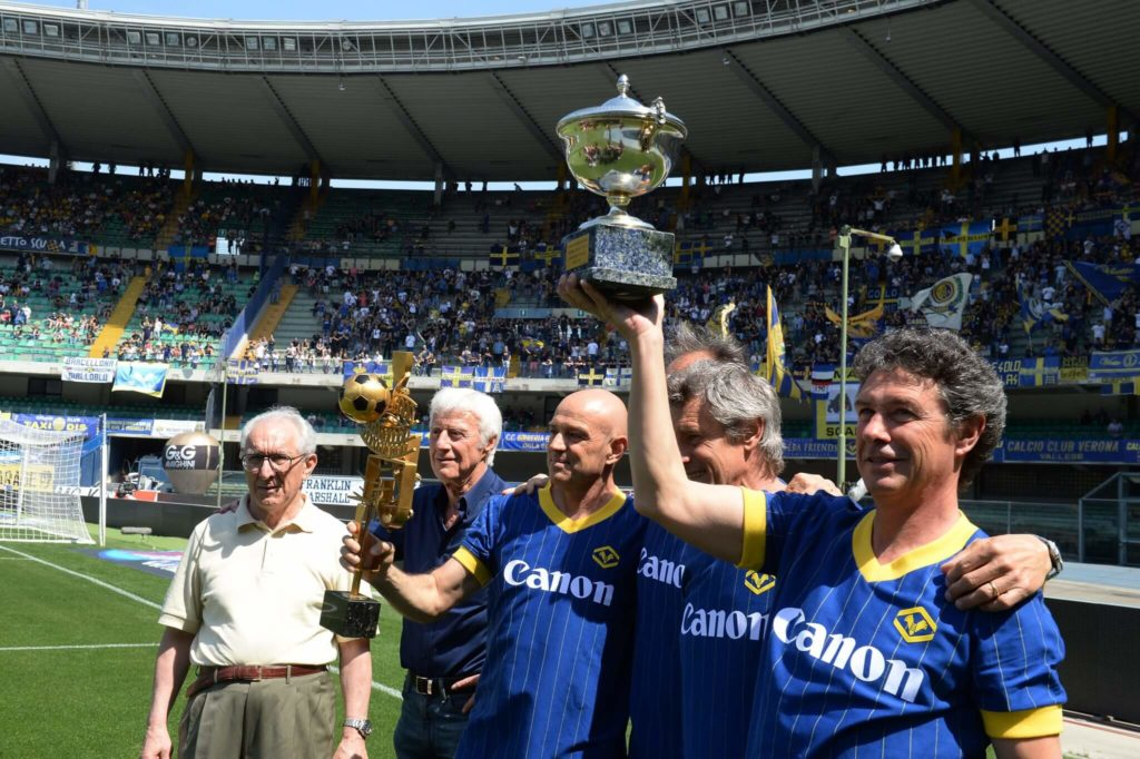 VERONA, ITALY - MAY 17: Eugenio Bagnoli head coach Verona 1984 / 1985 and players of Verona celebrates for thirty years of championship celebrations before the Serie A match between Hellas Verona FC and Empoli FC at Stadio Marc'Antonio Bentegodi on May 17, 2015 in Verona, Italy. (Photo by Dino Panato/Getty Images)