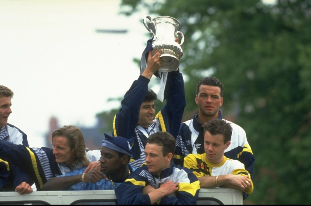 1991: Nayim of Tottenham Hotspur holds the trophy aloft during their homecoming after the FA Cup final against Nottingham Forest at Wembley Stadium in London. Tottenham Hotspur won the match 2-1. Mandatory Credit: Ben Radford/Allsport