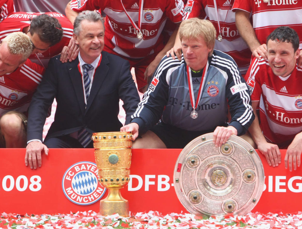 MUNICH, GERMANY - MAY 17: Goalkeeper Oliver Kahn (2nd-R) and his head coach Ottmar Hitzfeld (2nd-L) pose with the German Championship trophy (R) and the DFB Cup trophy (L) after the Bundesliga match between FC Bayern Munich and Hertha BSC Berlin at the Allianz Arena on May 17, 2008 in Munich, Germany.