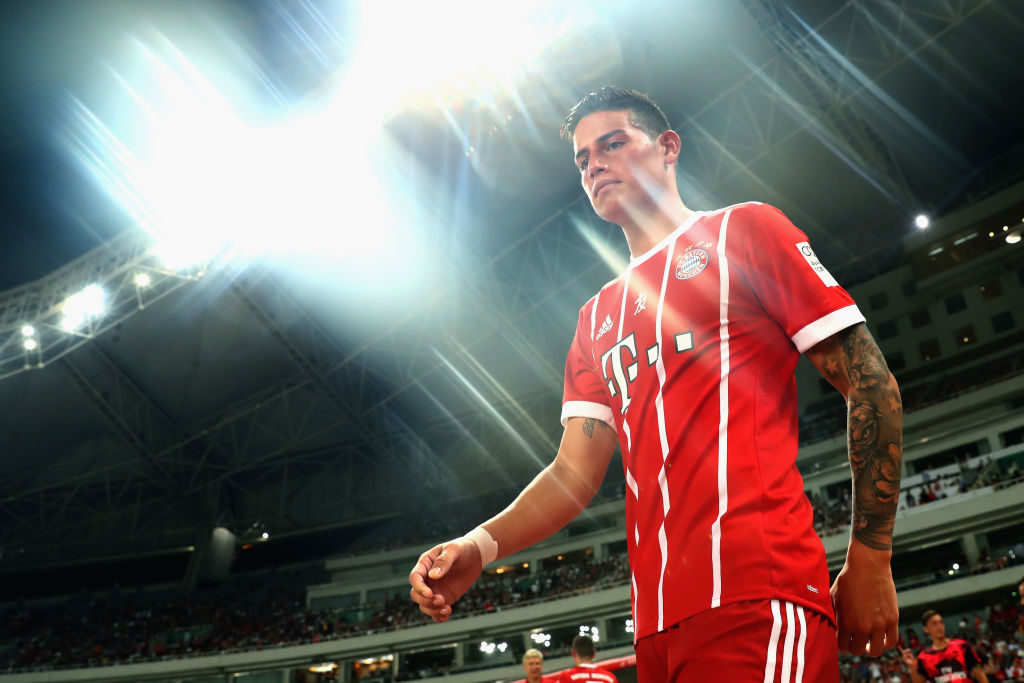 SHANGHAI, CHINA - JULY 19: (EDITORS NOTE: STAR EFFECT FILTER USED TO CREATE THIS PICTURE!) James Rodriguez of Bayern Muenchen enters the field of play for the Audi Football Summit 2017 match between Bayern Muenchen and Arsenal FC at Shanghai Stadium during the Audi Summer Tour 2017 on July 19, 2017 in Shanghai, China. (Photo by Alexander Hassenstein/Bongarts/Getty Images)