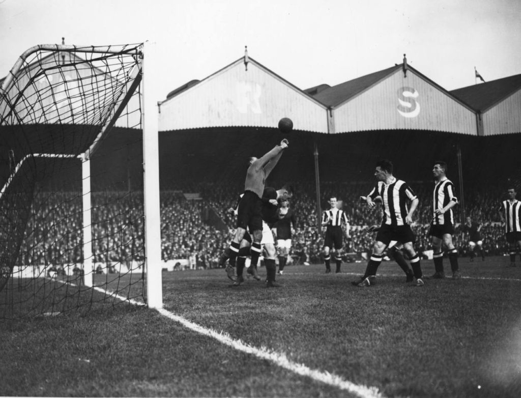 2nd October 1926:  The Newcastle United goalkeeper punches away an Arsenal cross, during the match against Arsenal at Highbury.