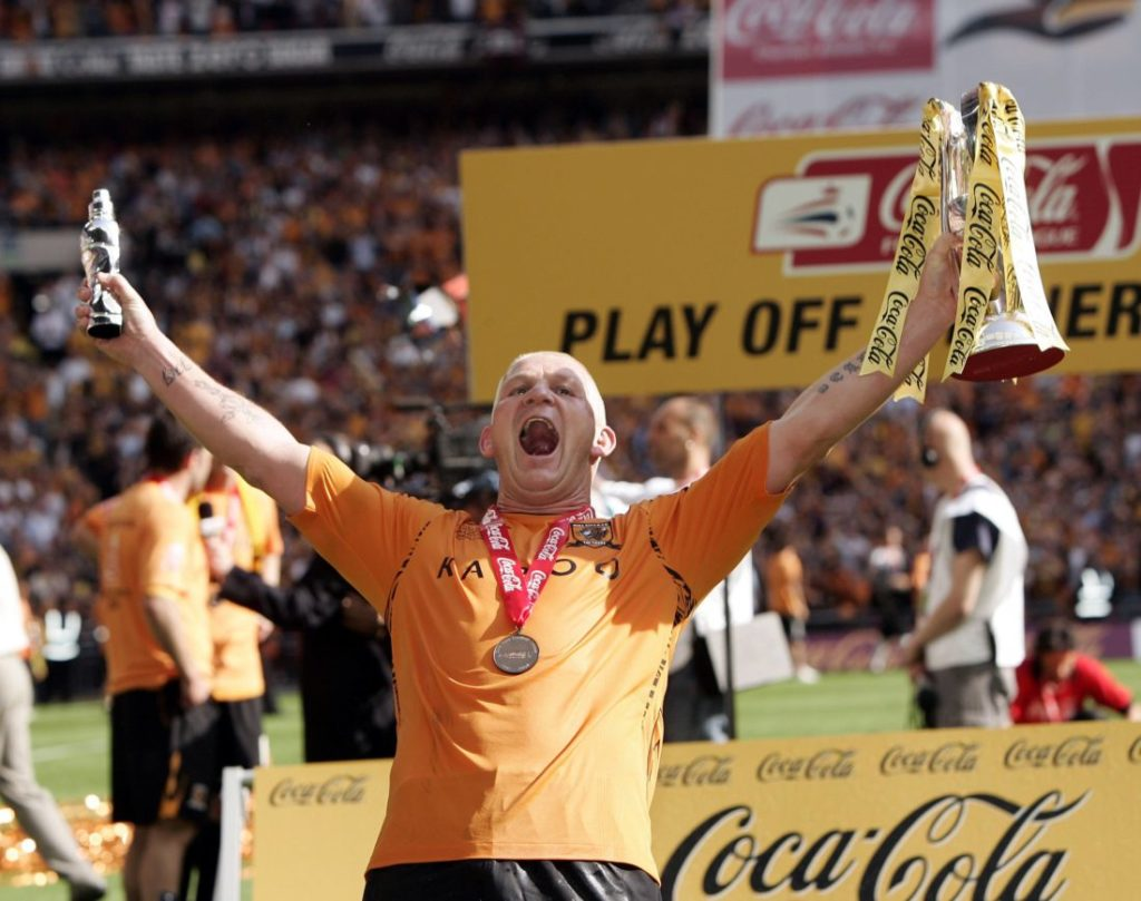 Dean Windass (Hull City) celebrates the Ascent with his Trophy.