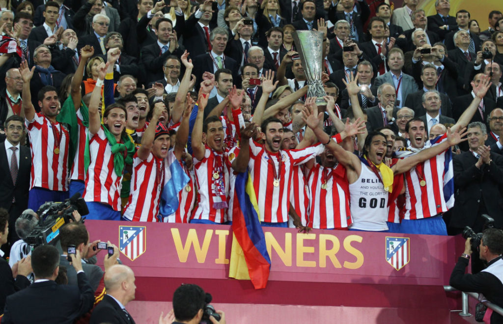 BUCHAREST, ROMANIA - MAY 09: The Atletico Madrid players celebrate with the trophy at the end of the UEFA Europa League Final between Atletico Madrid and Athletic Bilbao at the National Arena on May 9, 2012 in Bucharest, Romania.