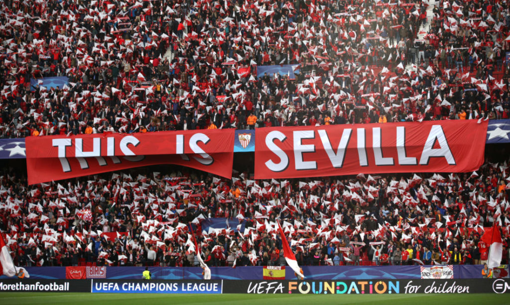SEVILLE, SPAIN - APRIL 03: Sevilla fans hold up a banner prior to the UEFA Champions League Quarter Final Leg One match between Sevilla FC and Bayern Muenchen at Estadio Ramon Sanchez Pizjuan on April 3, 2018 in Seville, Spain.