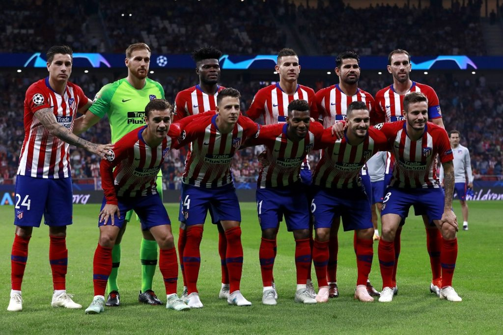 MADRID, SPAIN - OCTOBER 03: Atletico Madrid line up prior to the Group A match of the UEFA Champions League between Club Atletico de Madrid and Club Brugge at Estadio Wanda Metropolitano on October 3, 2018 in Madrid, Spain.