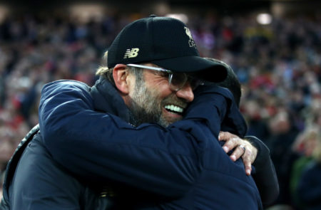LIVERPOOL, ENGLAND - APRIL 09: Jurgen Klopp, Manager of Liverpool and Sergio Conceicao, Manager of FC Porto embrace prior to the UEFA Champions League Quarter Final first leg match between Liverpool and Porto at Anfield on April 09, 2019 in Liverpool, England.