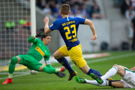 MOENCHENGLADBACH, GERMANY - APRIL 20: Marcel Halstenberg of Leipzig (#23) scores his second goal during the Bundesliga match between Borussia Moenchengladbach and RB Leipzig at Borussia-Park on April 20, 2019 in Moenchengladbach, Germany.