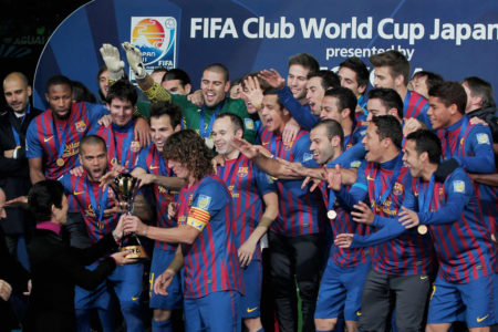 YOKOHAMA, JAPAN - DECEMBER 18: Barcelona captain Carles Puyol lifts the trophy amongst team-mates celebrating after the FIFA Club World Cup Final match between Santosl and Barcelona at the Yokohama International Stadium on December 18, 2011 in Yokohama, Japan.