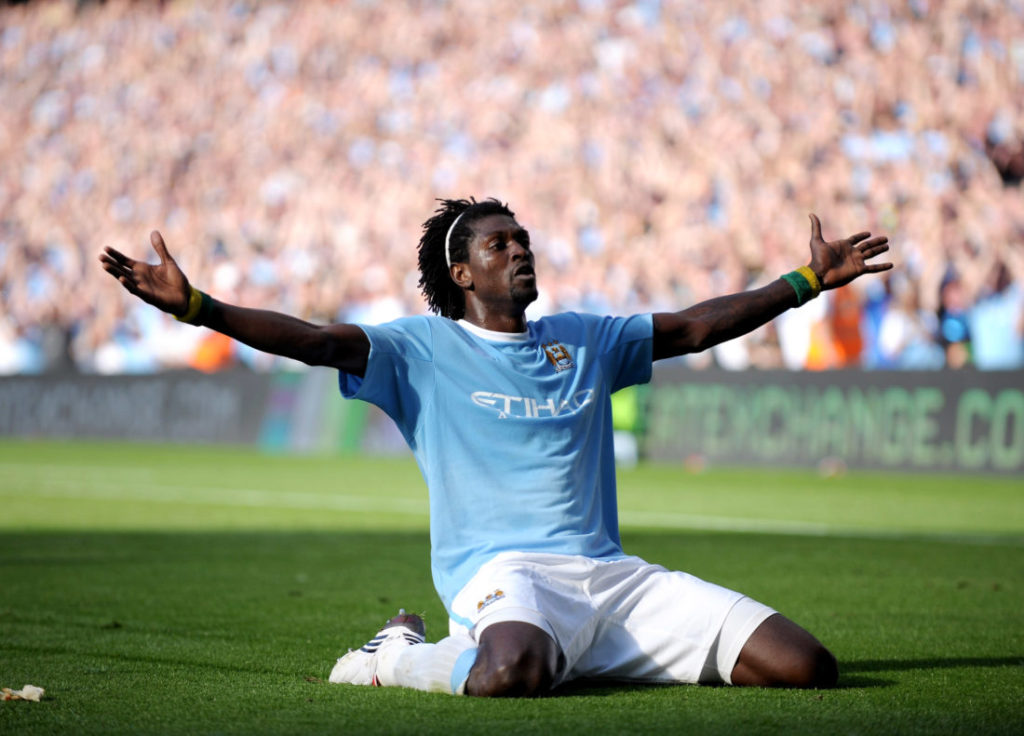 MANCHESTER, ENGLAND - SEPTEMBER 12: Emmanuel Adebayor of Manchester City celebrates in front of the Arsenal fans after scoring during the Barclays Premier League match between Manchester City and Arsenal at the City of Manchester Stadium on September 12, 2009 in Manchester, England.