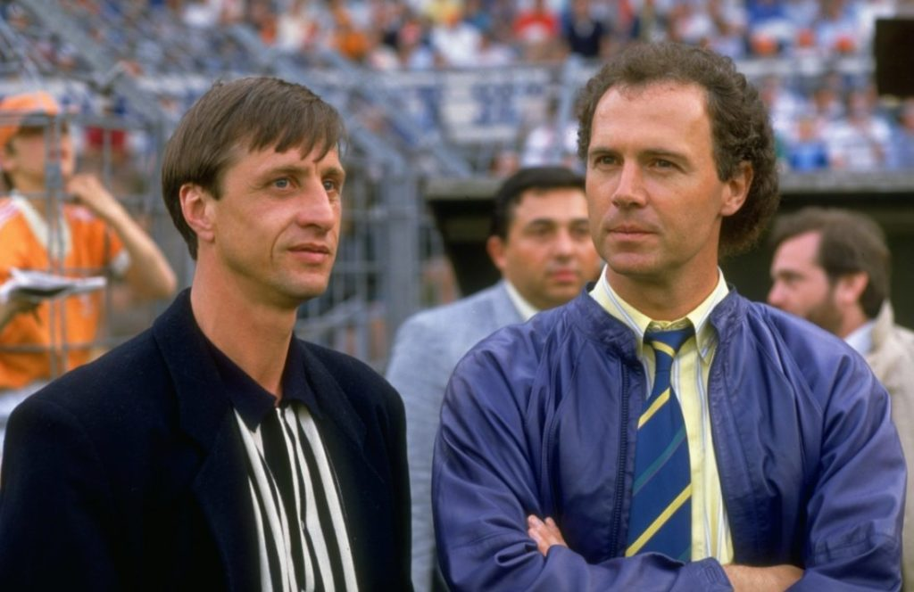 1987: Franz Beckenbauer (right) of West Germany stands with Johan Cruyff of Holland during the European Championship qualifying match between Holland and Hungary in Holland. Holland won the match 2-0.