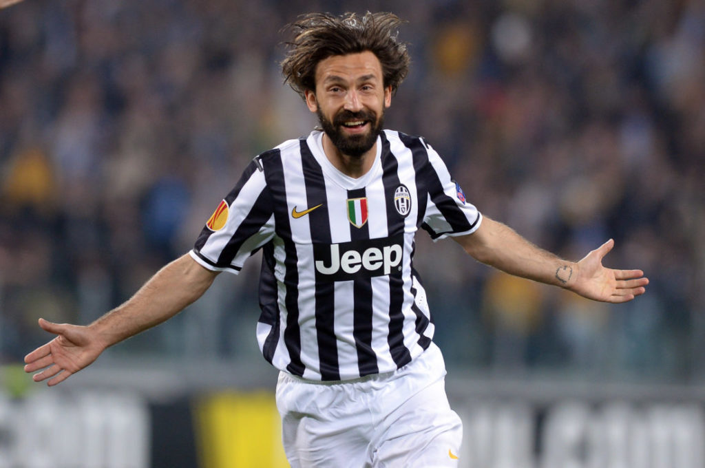 TURIN, ITALY - APRIL 10: Andrea Pirlo of Juventus celebrates scoring the first goal during the UEFA Europa League quarter final match between Juventus and Olympique Lyonnais at Juventus Arena on April 10, 2014 in Turin, Italy.