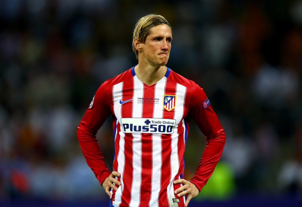 MILAN, ITALY - MAY 28: Fernando Torres of Atletico Madrid cries after losing the UEFA Champions League Final match between Real Madrid and Club Atletico de Madrid at Stadio Giuseppe Meazza on May 28, 2016 in Milan, Italy.