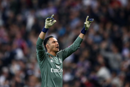 MADRID, SPAIN - MAY 01: Keylor Navas of Real Madrid celebrates as Karim Benzema of Real Madrid scores his sides second goal during the UEFA Champions League Semi Final Second Leg match between Real Madrid and Bayern Muenchen at the Bernabeu on May 1, 2018 in Madrid, Spain.