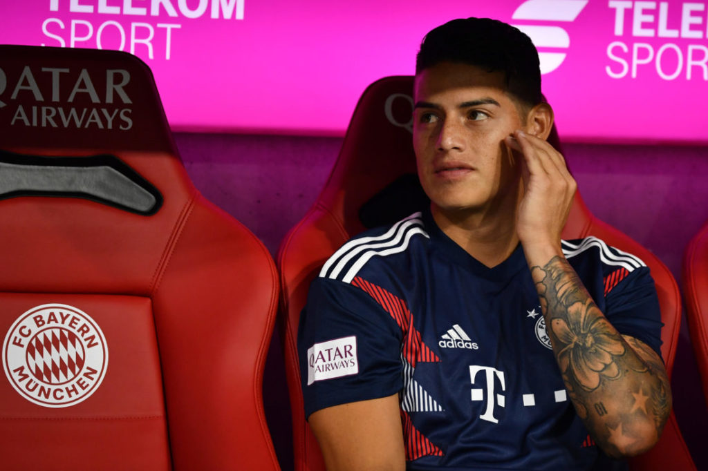 MUNICH, GERMANY - AUGUST 24: James Rodriguez of Bayern Muenchen sits on the bench during the Bundesliga match between FC Bayern Muenchen and TSG 1899 Hoffenheim at Allianz Arena on August 24, 2018 in Munich, Germany. (