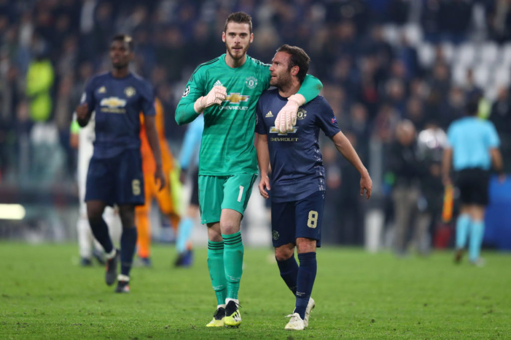 TURIN, ITALY - NOVEMBER 07: David De Gea of Manchester United celebrates victory with Juan Mata of Manchester United after the UEFA Champions League Group H match between Juventus and Manchester United at Juventus Stadium on November 7, 2018 in Turin, Italy.