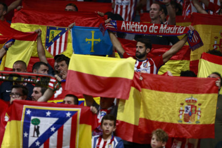 MADRID, SPAIN - OCTOBER 14: Atletico de Madrid fans holding the Spanish and the Club's flag prior to start the La Liga match between Club Atletico Madrid and FC Barcelona at Estadio Wanda Metropolitano on October 14, 2017 in Madrid, Spain.