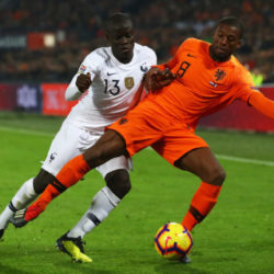 ROTTERDAM, NETHERLANDS - NOVEMBER 16: Georginio Wijnaldum of the Netherlands is fouled by N'Golo Kante of France during the UEFA Nations League Group A match between Netherlands and France at the Stadion Feijenoord on November 16, 2018 in Amsterdam, Netherlands.