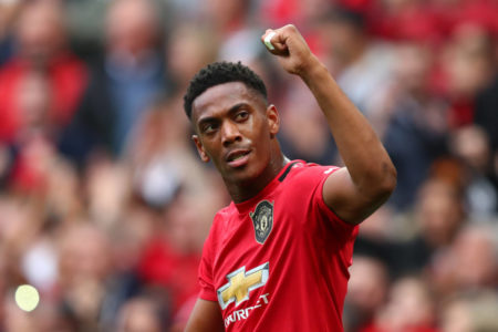 MANCHESTER, ENGLAND - AUGUST 11: Anthony Martial of Manchester United celebrates after scoring his team's second goal during the Premier League match between Manchester United and Chelsea FC at Old Trafford on August 11, 2019 in Manchester, United Kingdom.