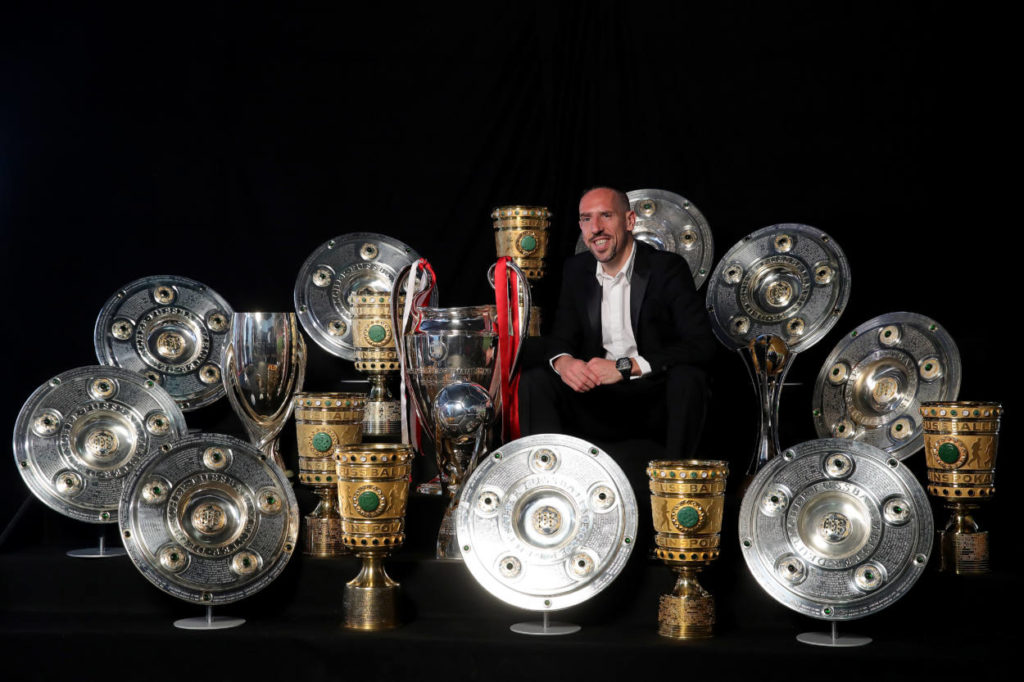 MUNICH, GERMANY - MAY 28: Franck Ribery poses for a picture with all his trophys won with the FC Bayern Muenchen team during an event at FCB Erlebniswelt on May 28, 2019 in Munich, Germany. at FCB Erlebniswelt on May 28, 2019 in Munich, Germany. (Photo by Alexander Hassenstein/Bongarts/Getty Images)