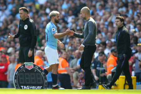 Josep Guardiola, Manager of Manchester City congratulates Sergio Aguero of Manchester City