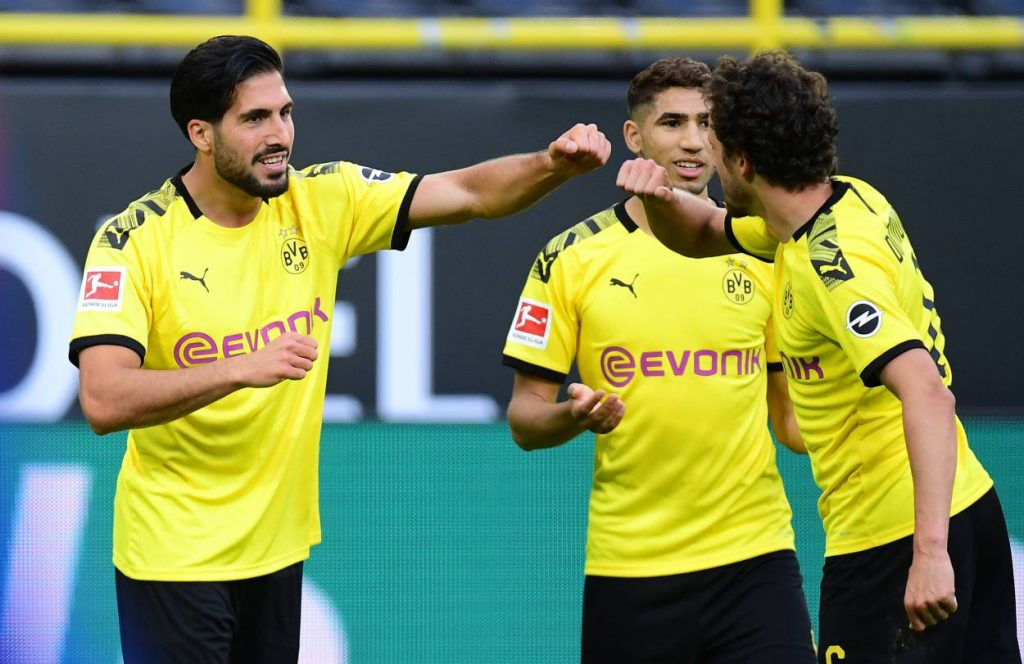 Tor Jubel beim Fussball Bundesliga Spiel Borussia Dortmund - Hertha BSC (1:0). Torschütze Emre Can freut sich mit Achraf Hakimi und Thomas Delaney.