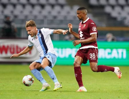 Ciro Immobile and Marco Parolo scored as Lazio came from behind to beat Torino by 2-1. Andrea Belotti scored for the home side.