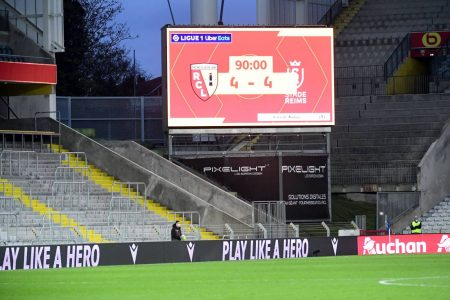 Lens scored twice in injury time to earn a point after a 4-4 draw against Reims and cement their 11th place in Ligue 1.