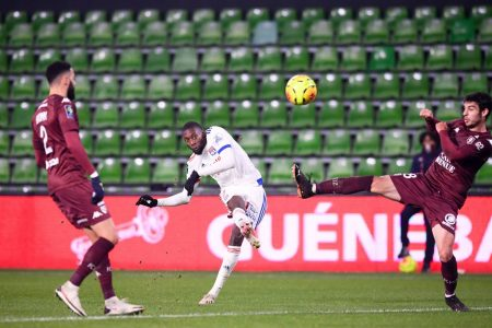 Karl Toko Ekambi scored twice in the second half as in-form Lyon beat Metz 3-1 to move third in Ligue 1 table.