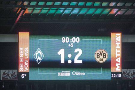 Marcus Reus scored the winner as Borussia Dortmund move fourth in Bundesliga with a 2-1 win over Werder Bremen.