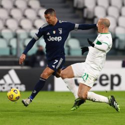 Late goals from Aaron Ramsey and Cristiano Ronaldo inspire Juventus to a much-needed win over 10-man Sassuolo.